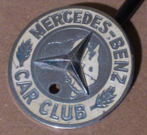 A well worn, original MBCCWA radiator badge.