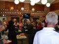 Members mingling around the food.