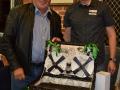 ...Joseph Kraszlan, being congratulated by President Trent Chellingworth