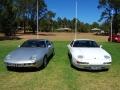 A pair of Porsche 928s